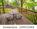 picnic table on porch patio...   Shutterstock . vector #1105111964