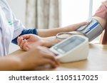 doctor and patient measuring... | Shutterstock . vector #1105117025