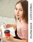 girl writing pen in notebook.... | Shutterstock . vector #1105133861