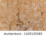brown adobe clay wall texture... | Shutterstock . vector #1105135385