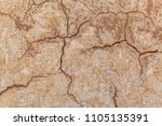 brown adobe clay wall texture... | Shutterstock . vector #1105135391
