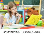cute little schoolgirl at home   Shutterstock . vector #1105146581