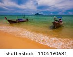 traditional long tail boat at... | Shutterstock . vector #1105160681