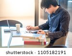 young asian man student reading ... | Shutterstock . vector #1105182191