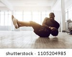 athletic man doing abdomen... | Shutterstock . vector #1105204985