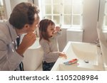 father and daughter brushing... | Shutterstock . vector #1105208984