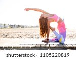 Woman Practicing Yoga At The...