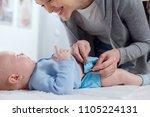 mom changes a reusable diaper...   Shutterstock . vector #1105224131