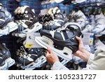 hands of man with hockey skates ... | Shutterstock . vector #1105231727