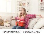 happy little girl unpacking... | Shutterstock . vector #1105246787
