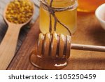 glass honey jars and dipper on... | Shutterstock . vector #1105250459