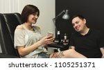 man and woman choosing tattoo... | Shutterstock . vector #1105251371