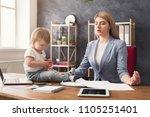 business mom meditating during... | Shutterstock . vector #1105251401