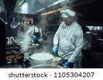 shot of a chef cooking in a... | Shutterstock . vector #1105304207