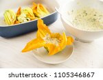 zucchini  or courgette flowers... | Shutterstock . vector #1105346867