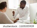 serious multiracial workers... | Shutterstock . vector #1105355939