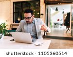 surprised man looking at laptop ... | Shutterstock . vector #1105360514