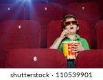 surprised boy eating popcorn in ... | Shutterstock . vector #110539901