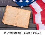 usa flag and old opened book.... | Shutterstock . vector #1105414124