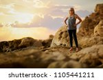 cheering young woman backpacker ... | Shutterstock . vector #1105441211