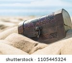 big closed treasure chest on... | Shutterstock . vector #1105445324