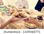 muslim family having a ramadan... | Shutterstock . vector #1105460771