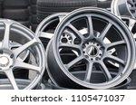 wheel rims on showcase. car... | Shutterstock . vector #1105471037