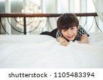 lazy boy kid happy waking up in ... | Shutterstock . vector #1105483394