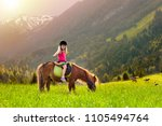 kids riding pony in the alps...   Shutterstock . vector #1105494764