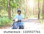 men riding their scooter... | Shutterstock . vector #1105527761