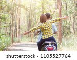 couple riding their scooter... | Shutterstock . vector #1105527764