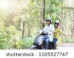 couple riding their scooter... | Shutterstock . vector #1105527767