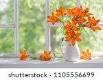 orange lily on windowsill | Shutterstock . vector #1105556699