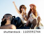 group of cheerful friends... | Shutterstock . vector #1105592744