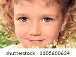 the child's portrait with curly ... | Shutterstock . vector #1105600634