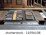 wood type clamped into a printer's chase just before inking, against a background of printer's furniture - stock photo