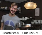 waiter serving coffee and... | Shutterstock . vector #1105620071