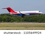 Small photo of Borispol, Ukraine - May 26, 2018: N79AY Bombardier BD-700-1A10 Global Express business jet aircraft landing on the runway of Borispol International Airport. Editorial use only