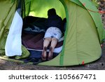 Stock photo dirty feet of a child in a tent 1105667471