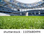 grass on stadium in sunlight.... | Shutterstock . vector #1105680494