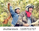 senior couple riding a classic... | Shutterstock . vector #1105711727