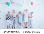 happy senior people with... | Shutterstock . vector #1105719137