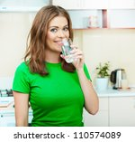 young woman drinking water at... | Shutterstock . vector #110574089