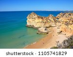 Small photo of PORTIMAO, PORTUGAL - JUNE 7, 2017 - Elevated view of the rocky coastline with tourists relaxing on the sandy beach, Praia da Rocha, Algarve, Portugal, Europe, June 7, 2017.