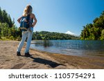 woman tourist stands on the... | Shutterstock . vector #1105754291