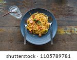 fried spaghetti with bacon on...   Shutterstock . vector #1105789781