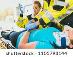 medics with injured woman... | Shutterstock . vector #1105793144