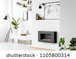 poster above black fireplace in ... | Shutterstock . vector #1105800314