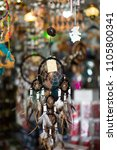 dreamcatchers in a market stall.... | Shutterstock . vector #1105800341