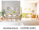 white chairs at wooden dining... | Shutterstock . vector #1105811681